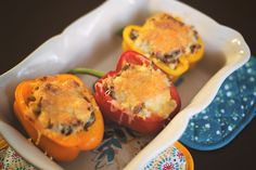 These low carb stuffed peppers are filled with delicious cauliflower rice, sausage, and gouda. The leftovers make great lunches for busy moms too!