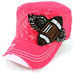 Football with Wings Rhinestone Patch Cadet Cap Hot Pink  Rock this football cadet like the #1 fan that you are. Everyone will be sure to notice your style and team spirit!  Rhinestone football patch  Distressed cadet  Adjustable back