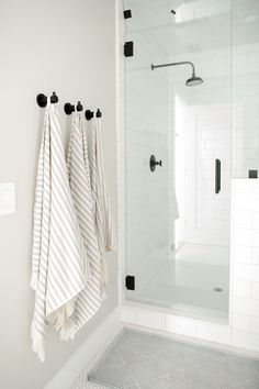Bathroom with cool tones, black hardware - Studio McGee Blog