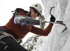 """Pete Davis, of Boulder, Colo., climbs with his new prosthetic ice tool during Gimps On Ice at the Ouray Ice Park in Ouray, Colo., March 13, 2010."" Caption at link"