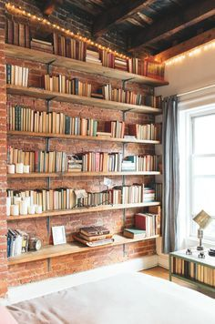 Wonderful bookshelf in this transformed loft made into a warm, comfortable and cosy home entirely furnished from their store, Three Seven. My favourite part is the internal window from the main bedroom looking into Muse's room, beautiful don't you think?