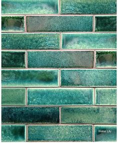 """SenecaStudio SenecaStudio SenecaStudio is a new collection featuring a unique hand glazing technique that leaves a fluid blending of shades much like a watercolor painting: Water Lily, Amber Waves and Blue Lagoon. From the more contemporary straight edged to completely hand made, SenecaStudio offers a thin brick size in all Seneca Tiles colors. Nine shapes adding drama and style to any setting. Narrow single color """"ranges"""" to shaded colors to custom blends of multiple colors."""