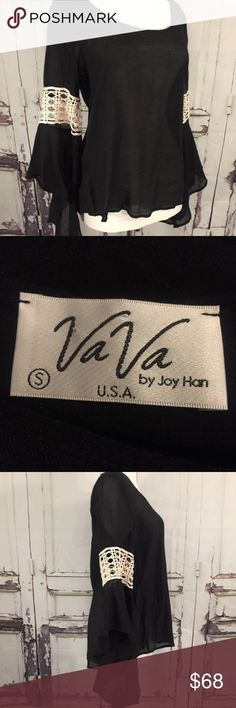 VaVa Joy Han Black & White Lace Bell Sleeve Blouse This is a spectacular item from Joy Han the VaVa line is quality and stylish   Black with white lace cut-outs in the sleeves.   Bell sleeve from the lace down, really nice.   Round Neckline - Sheer /Slightly See-Through - Sexy   * Measurements shown within the photos. Vava by Joy Han Tops Blouses