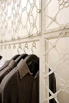 """Fashion designer Rajeesh Pratap Singh's store in the Emporio Mall, New Delhi, India, features scissor walls and hanging space. Architects LOTUS used the tailor's tool as a metaphor of industrial craft to come up with the brilliant design which inserts a """"skin"""" - a lacework of scissors - into a generic store space."""