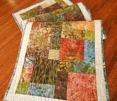 Quilted Batik Table Runner, Moda Sticks and Stones, Blue Brown Rust and Green, Batik Table Topper, Quilted Batik Table Mat by susiquilts on Etsy