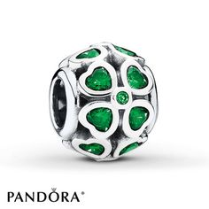 Four-leaf clovers depicted in green cubic zirconias dance all over this sterling silver charm from the PANDORA Spring 2015 collection. Style # 791496CZN.