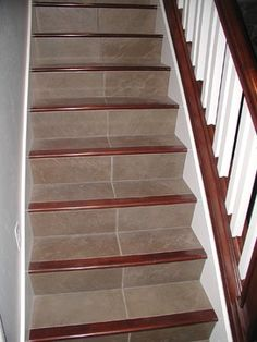 Stair Case - Natural Stone Risers. White painted risers always get ...