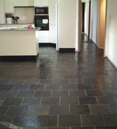 slate floor tile - would look good right in front of the fireplace