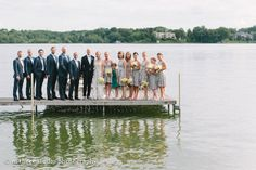 Wedding Party out on the dock.  Styling and Florals by Gracious Events Delafield Fish Hatchery Wedding Lakeside Wedding #fishhatcherywedding #alfrescowedding #rusticwedding #aquawedding