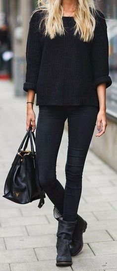 More monochromatic. Love the loose, chunky knit and moto boots. Would love to find a cozy sweater that drapes perfectly - three season staple, for sure.
