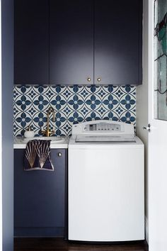 Blue laundry room tiles
