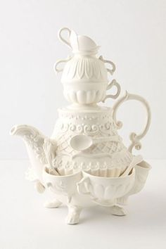 Stanhope Teapot ~ Inspired by china found in English teashops, dainty layers of cups and bowls fan outwards, like the tiered layers of woman's 18th century dressing gown.