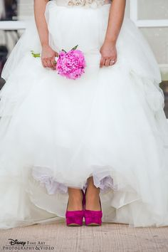 Think pink with shoes that add a pop of color to a white wedding gown #wedding #shoes #heels #pink