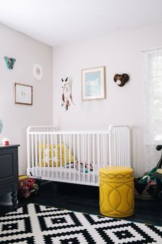 Graphic black + white nursery. Love this so so soooo much. Mix a classic crib with a modern rug. So great