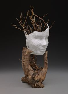 """Kristin Ham, Plano Senior High School, """"Two Face"""": """"My piece was inspired by the idea that there are two different sides to a story. Using movement, texture, and form in my piece, I rested two paper mâché mannequin faces together in an interesting piece of wood. Realistic branches were added, representing that at the root of every lie there is truth."""""""