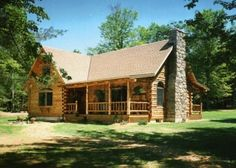 """Love log homes! ... this is """"close"""" but mine needs to have a huge deck/porch, and a big dramatic window wall on either side of that stone chimney ."""