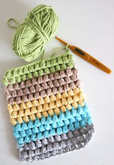 A bobble stitch scarf in yummie colors.