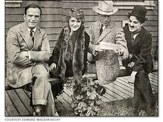 The founders of United Artists: Douglas Fairbanks, Mary Pickford, D. W. Griffith, and Charlie Chaplin.