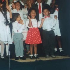 I'm probably around 6 years old in this picture taken at a church Sunday school concert. Singing in church is where I started singing. I don't know about other communities but in coloured churches we were always colour coordinated, hence the red and white matchy outfits 😍 Note, the boy on the left was clearly in love with me and the one on the right is obviously not vibing with my diva energy ❤️ #whereitallbegan #kinndom #singer #femalesinger First Love, My Love, Female Singers, No One Loves Me, Sunday School, Red And White, Diva, Singing, Note