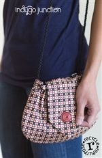 "With Indygo Junction's Tie-to-Go purse pattern, you can repurpose a man's tie to create a fashionable bag. Wear with a crossbody strap created from pre-made cord. Inside is fully lined with pocket. Two options for finishing, with or without boxed bottom. Finished size of version without boxed bottom: 6"" tall x 9"" wide. Finished size of version with boxed bottom: 6"" tall x 6.5"" wide. $9.99 www.indygojunction.com"