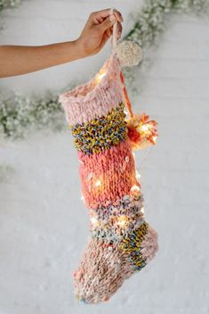 Looking for the perfect Christmas stocking pattern? The Knit Collage Holiday Stocking pattern has you covered! This knit stocking (made here with just 1 of our mini skein sampler kits in Rose) is a quick knit, and the perfect gift this holiday season! Click through for more fun pattern and yarn details! #christmasstocking #homepatterns #knitstocking