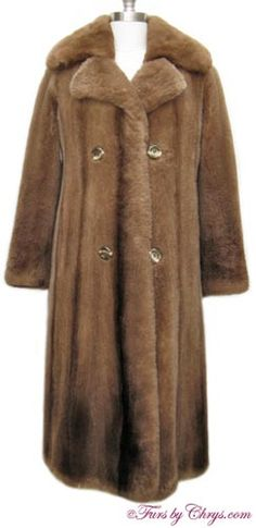 SOLD! Vintage Sheared Raccoon Fur Coat #SR670; Excellent Condition; Size range: 2 - 6 Petite. This is a beautiful vintage genuine sheared raccoon fur coat. It has an Albrecht's label, and features a large notched collar and lovely striations.  The lining is solid brown with an almost invisible monogram. It closes with buttons and loops and there is a button at the collar area. Raccoon fur is a very warm fur, and this charming sheared raccoon coat will keep you toasty!