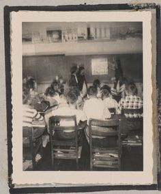 Photograph of a classroom full of students observing a poster on a chalkboard wall, Clarkesville, Habersham County, Georgia, 1950. Northeast Georgia Regional Library System.