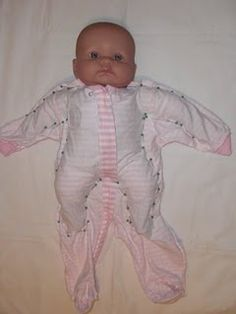 Make baby clothes into doll clothes.  @Alescia Colvin-you might need this some day.  And you can put your new sewing machine to work!