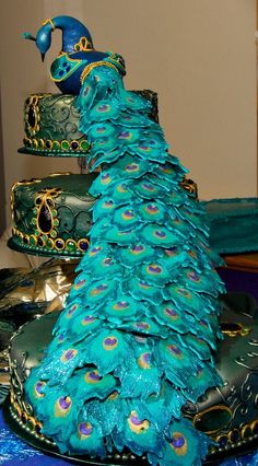 Wedding cakes play a significant part in the wedding party. A wedding cake may be a significant part your big day. The traditional wedding cake is definitely round, but the simple truth is there ar… Peacock Cake, Peacock Wedding Cake, Indian Wedding Cakes, Amazing Wedding Cakes, Amazing Cakes, Indian Weddings, Indian Cake, Nigerian Weddings, African Weddings