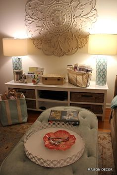 Fantastic Tin Tile Medallion is a focal point over a console table that has tons of storage to hold bills and paperwork while keeping things neat and stylish. Fab pair of lamps finishes it off. All from HomeGoods! Sponsored pin by Happy by Design HomeGoods.