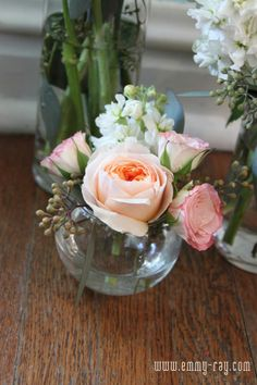 Small floral arrangement to match boutinere and bridal bouqet.