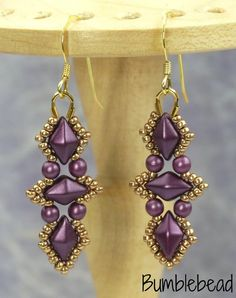 This tutorial guides you through making a pair of Aztec Diamond Earrings and the Aztec Diamond Bracelet,using step by step photography alongside detailed instructions.  The patterns require: DiamonDuos (21), 3mm pearls (40), 2g size 15 Miyuki seed beads, wire guardians (2), Clasp, 6lb Fireline, beading needle, scissors.  The tutorial is suitable for a beginner with a little experience. I am happy for you to sell items made using the tutorial locally, in galleries and at local craft fairs. I…