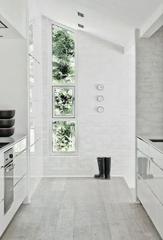 light floors with white washed brick and white laquer applaince