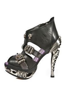 These Black Magneto Sandals from New Rock, feature a zipper, 2 skull-buckles, skull-rivets with gem and spike decorations. The Stiletto high heel and front platform are made in a very unique Bio-mechanic style. Available through www.macabrecouture.com.au
