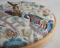 DIY clock with patterned fabric and buttons