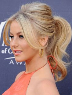 Dancer Julianne Hough shows off the ponytail of Barbie dreams! Her hair has been blow-dried, curled at the ends and backcombed at the crown for added oomph, before being tied into a pony right at the back of her head. Its a swishy, sexy kind of ponytail, complete with a Brigitte Bardot-esque centre-parted fringe.