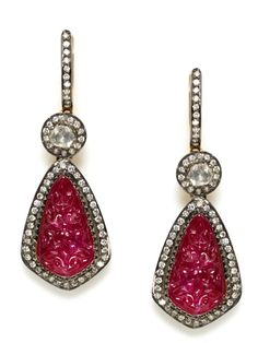 The carved ruby makes these stand out. (Diamond & Carved Ruby Drop Earrings | Amrapali)