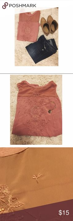 Embellished Blush Top This sleeveless top has so much detail! Material is 100% polyester. There is one small bead missing (third picture) but it's really not noticeable Tops Blouses