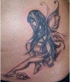 Black and white fairy tattoos