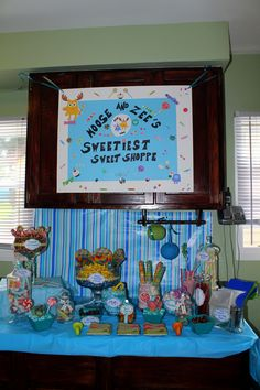 I made the sign & hung it- then just put candy in dishes and apothecary jars and labeled them. Had scoops and treat bags as well.