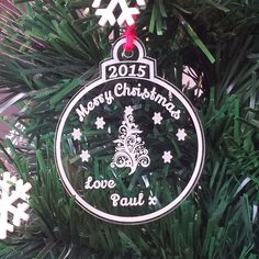 Personalised for a special first Christmas together or for celebrating a baby's first. Featuring a bauble shape engraved with a delicate tree and snowflakes. Christmas Tree Baubles, Christmas Tree Decorations, Christmas Bulbs, Holiday Decor, First Christmas, Snowflakes, Delicate, Ribbon, Shapes