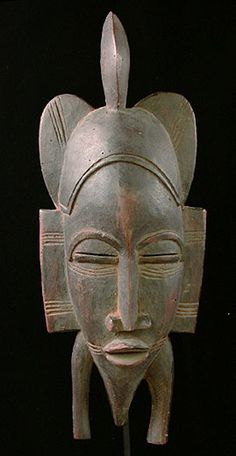 Kpelie mask Senufo people, Ivory Coast 14 inches, stained wood
