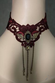 Gothic choker: Dark red lace with brass orbaments and a black stone. Steampunk victorian baroque. $39.90, via Etsy.