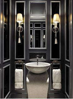 drama in the powder room....see how an ordinary 'small room' is transformed by wall panelling and a splash of dark paint