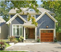 Not the same style as our house but this is my first choice for siding & I think… – Decoration ideas Wood Exterior Door, House Paint Exterior, Garage Door Colors, Blue Siding, Modern Garage Doors, Facade House, House In The Woods, House Painting, Windows And Doors