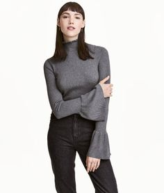 Dark gray melange. Fitted sweater in a soft, viscose-blend rib knit. Stand-up collar with ruffle trim and long sleeves with wide flounce at cuffs.