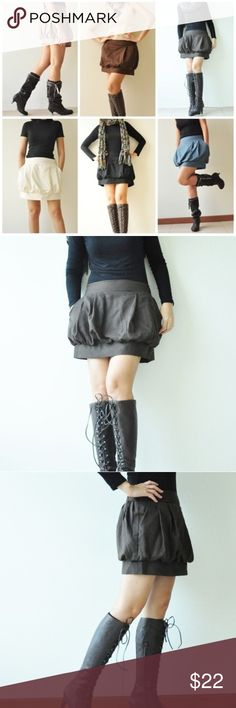 """Tulip Skirt Dark Brown Thailand artisan made Tulip skirt! Bought on Etsy. Cool, VERY comfortable, great condition, breezy, dark brown. Has pockets! Size medium, comfortably fits waist 26""""-30"""". Back of waist is elastic, front lies flat. 15"""" length. Make me an offer! Skirts Mini"""