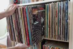 Cut-out Record Sleeves Create Secret Storage on the Bookshelf