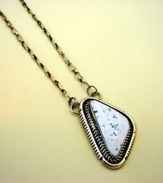Sterling Silver Necklace Featuring White Magnacite.