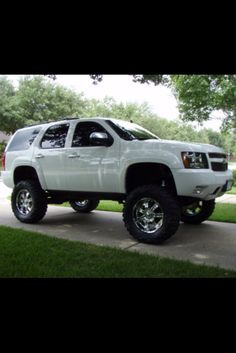 Since I'm never going to be able to fit all of the children Robbie and I want in a truck, we decided on something like this. Still lifted and badass, but able to haul my big ass family (: